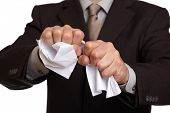 image of disrespect  - Angry businessman tearing up a document - JPG