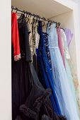 Many Ladies Evening Gown Long Dresses On Hanger In The Dress Rent Shop For The Wedding Day Or Photo  poster
