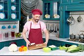 Bearded Chef In Apron And Cap Cut Mushrooms For Salad Holds Cutting Board In Hands. Champignon Ready poster