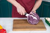 Close Up Of Cutting Half Of Red Cabbage. Closeup Of Man Hands With Knife And Red Cabbage. Red Cabbag poster