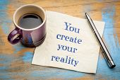 You create your reality - handwriting on a napkin with a cup of espresso coffee poster