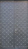 Black Double Metal Doors With Rhombic Pattern And Rivets. poster