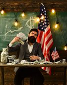 Economy And Finance. Economy Concept With Bearded Man Holding Money poster
