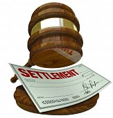 A gavel hovering over a check reading Settlement, illustrating an agreement overseen by the judicial