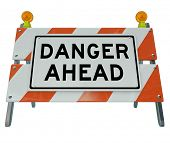 A road barrier reading Danger Ahead to signal that construction is on the road or public area and yo