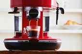 Making fresh coffee going out from a coffee espresso machine. Making espresso in glass transparent c poster