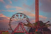 amazing fair photo with rides toned with a retro vintage instagram filter   poster