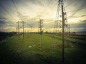 Vintage Tone Group Of Transmission Towers In Suburb Houston, Texas, Usa poster