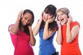 Teenage Girls Singing To Music On Mobile Phones