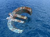 High resolution conceptual rusty metal euro symbol or sign sinking in water or sea as a metaphor or concept for crisis in Euope, ideal for financial,business or currency designs