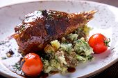 Tasty Turkey Leg In Sauce With Pounded Mashed Potatoes And Tomatoes On A Plate. Turkey With Garnish poster