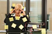 woman having stress in the office - multitasking and time management