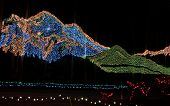 Mountains In Christmas Lights At Night