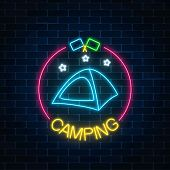 Neon Camping Sign With Tent, Stars And Flagsin Circle Frame On Dark Brick Wall Background. Glowing W poster