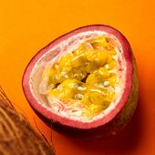 Fresh half passion fruit in top view for orange background. Ripe passion fruit so sweet and sour. Tr poster