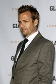 LOS ANGELES - OCT 24:  Gabriel Macht arrives at the 2011 Glamour Reel Moments Premiere at Directors Guild Of America on October 24, 2011 in Los Angeles, CA