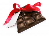 Sweet Chocolate with red ribbon - St. Valentines' day present. Isolated. Clipping path.