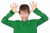 Funny child with green t-shirt mocking isolated on white background