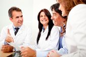foto of negotiating  - Group of doctors in a meeting with business people negotiating medical insurance - JPG