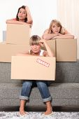 Three housemates with boxes