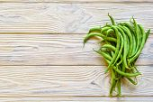 Bunch Of Freshly Picked Green Beans On A Wooden Surface poster