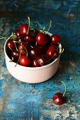 Bowl With Fresh Cherries On A Wooden Blue Background. Ripe Sweet Cherries. Healthy Food  Concept. Ch poster