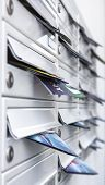 Mailboxes Filled Of Leaflets. Concept Of Spam And Junk Mail. poster