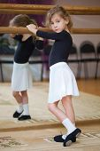 foto of ballet barre  - Little girl poses at ballet barre - JPG