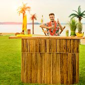 Handsome Bartender Standing Near The Bar Counter And Thumbs Up At The Resort In Rays Of The Sun, Pho poster