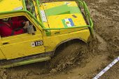 Yellow Terrain Vehicle Exceeds A Deep Pool