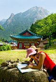 stock photo of seoraksan  - groups of travelers examining map in the Buddhist Sinheungsa Temple in Seoraksan National Park - JPG