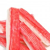 closeup of some crab sticks on a white background