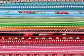 Pile of colorful cotton textile  background