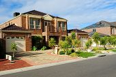 pic of front-entry  - Suburban Street with new modern houses on a beautiful sunny day - JPG