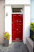stock photo of front door  - Red entrance door in front of residential house - JPG