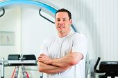 Space Curl - Portrait of a physical therapist in his practice in front an exercise machine