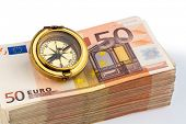 compass on euro banknotes, symbolic photo for europe, monetary union and the outlook for the europea