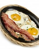 Fried Eggs And Bacon  In A Skillet