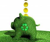 Coins Go Into A Recycling Piggy Bank Of Grass