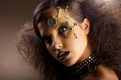 Artistry. Extraordinary Shiny Woman In Shadows. Golden Makeup. Creativity
