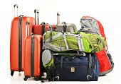 stock photo of knapsack  - Luggage consisting of large suitcases rucksacks and travel bag isolated on white - JPG