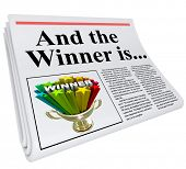 picture of raffle prize  - And the Winner Is headline on a newspaper with a photo of a winning trophy to celebrate and announce that someone won a competition - JPG