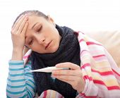 stock photo of pharyngitis  - Young woman suffering from the influenza and feel unwell - JPG