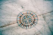 stock photo of wind-rose  - Old compass on vintage map - JPG