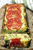 Zucchini and bacon slice, topped with tomatoes,  straight out of the baking tin.
