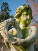 stock photo of cherub  - Cherub in the garden of Soestdijk Palace in the Netherlands holding a wreath - JPG