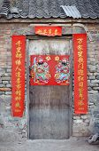 Old wooden door with fortune poster, China