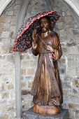 Wooden Carved Statue Of Jesus Holding An Umbrella