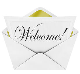 pic of cursive  - A formal card with the word Welcome written in cursive letters with a paper invitation and envelope - JPG