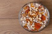 Dry muesli with nuts, raisins and dried apricots.